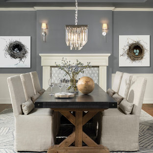 Dining room - traditional dining room idea in Denver with gray walls and a standard fireplace