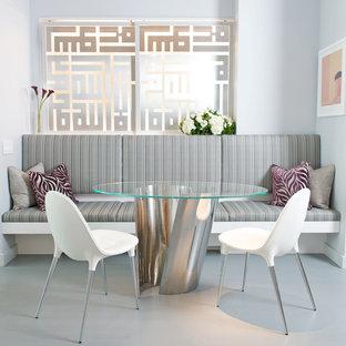 Modelo de comedor actual, de tamaño medio, cerrado, con paredes grises y suelo de mármol
