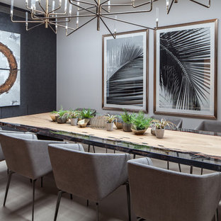 Design ideas for a contemporary dining room in London with black walls, no fireplace and beige floors.