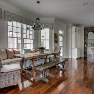 Example of a large classic medium tone wood floor dining room design in Nashville with gray walls