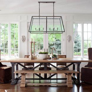 Large elegant dark wood floor dining room photo in Denver with white walls