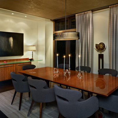 Inspiration for a large contemporary dark wood floor enclosed dining room remodel in Denver with beige walls and no fireplace