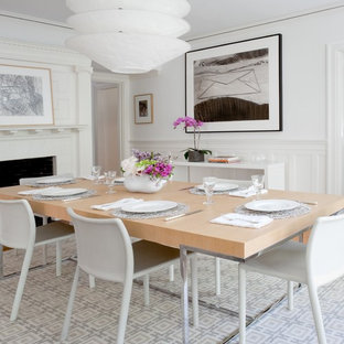 Dining room - contemporary dining room idea in Boston with white walls and a standard fireplace