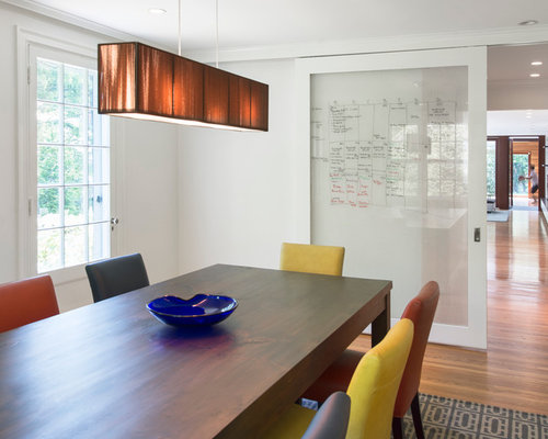 Trendy Enclosed Dining Room Photo In Boston With White Walls And Medium Tone Wood Floors