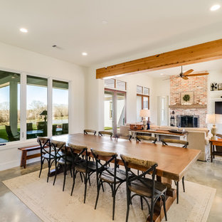 Great room - large farmhouse concrete floor and gray floor great room idea in Jackson with white walls, a standard fireplace and a brick fireplace