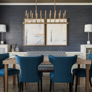 Example of a beach style medium tone wood floor enclosed dining room design in Salt Lake City with blue walls and no fireplace