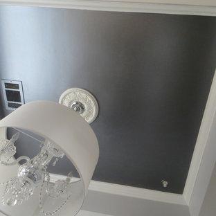 Modelo de comedor actual, pequeño, abierto, sin chimenea, con paredes grises