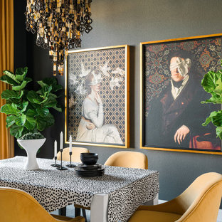 Inspiration for an eclectic enclosed dining room remodel in Chicago with black walls