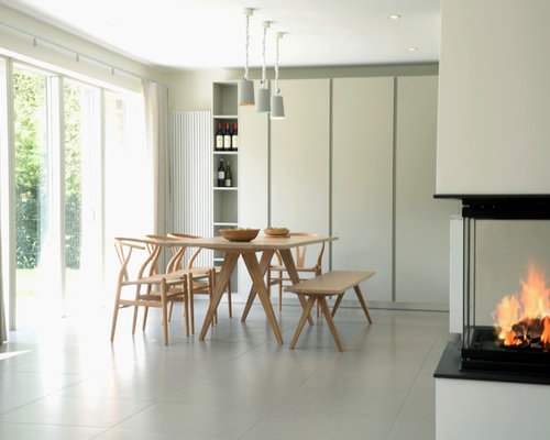 Photo Of A Modern Dining Room In Sussex With Grey Walls And A Corner  Fireplace.