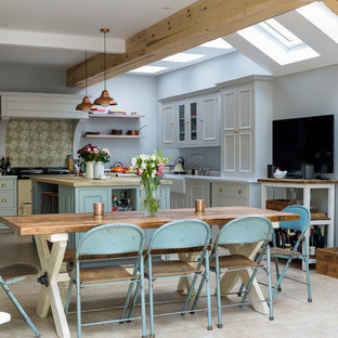 Inspiration for a medium sized rural kitchen/dining room in London with grey walls, limestone flooring and beige floors.