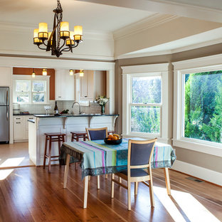 Inspiration for a mid-sized craftsman linoleum floor dining room remodel in Portland with beige walls