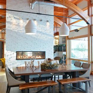 Dining room - industrial medium tone wood floor and brown floor dining room idea in Other