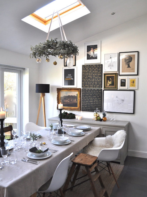 Example Of An Eclectic Dining Room Design In London With White Walls