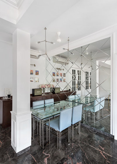 Contemporary Dining Room by Essajees Atelier