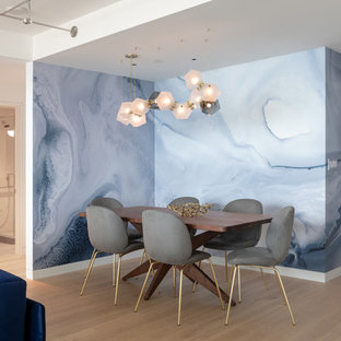 Example of a trendy beige floor and light wood floor great room design in San Francisco with blue walls