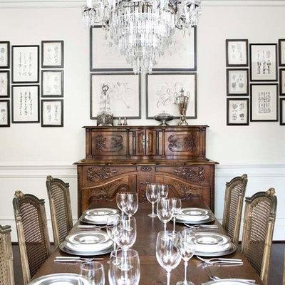 Enclosed dining room - large traditional dark wood floor enclosed dining room idea in Other with white walls