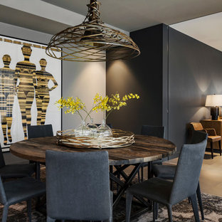 Contemporary open plan dining in Melbourne with black walls and beige floor.