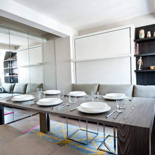 Inspiration for a small contemporary light wood floor dining room remodel in London with gray walls