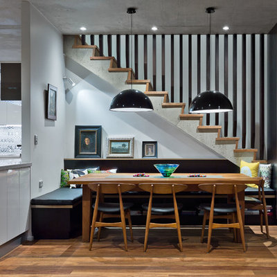Inspiration for a contemporary medium tone wood floor and brown floor kitchen/dining room combo remodel in Perth with white walls
