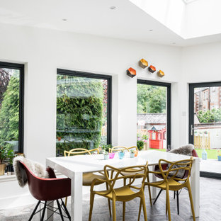 This is an example of a contemporary dining room in Glasgow.