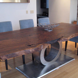 "Claro dining table - 100+ year old Claro Walnut Slab. This tree was fell (Late 90's) in Chico at the intersection of Spruce and West 6th. The natural form was maintained and preserved with a hand rubbed oil finish and contrasted with brushed stainless steel base. This is the longer part of a 16' slab made into a dining table (seats 10 to 12 people) measuring approximately: 11' x 4' x 30"" ."