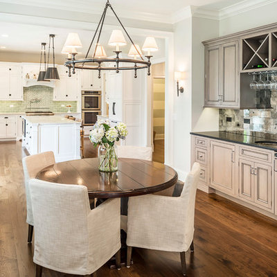 Example of a mid-sized classic medium tone wood floor kitchen/dining room combo design in Chicago with gray walls and no fireplace