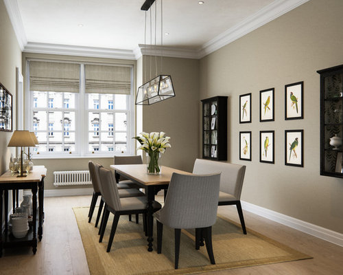 Medium Sized Traditional Dining Room In London With Beige Walls And Hardwood Flooring