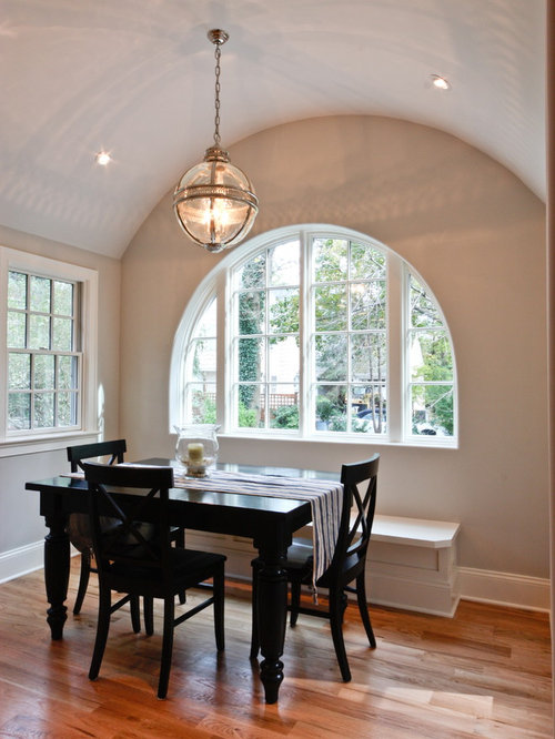 Inspiration for a timeless dark wood floor dining room remodel in Newark  with beige walls
