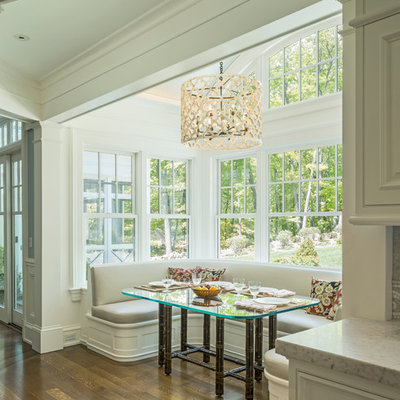 Kitchen/dining room combo - traditional medium tone wood floor and brown floor kitchen/dining room combo idea in Boston with white walls
