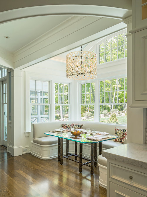 Traditional medium tone wood floor and brown floor kitchen/dining room  combo idea in Boston