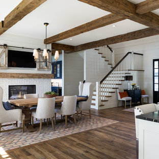 Inspiration for a cottage dark wood floor and brown floor great room remodel in Minneapolis with white walls