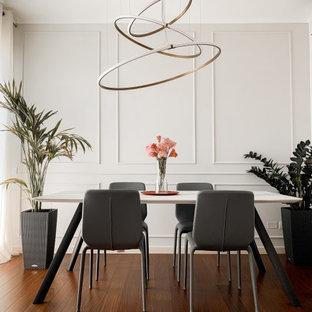 Foto di una sala da pranzo design di medie dimensioni con parquet scuro