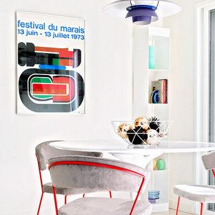 Foto de comedor moderno, pequeño, cerrado, sin chimenea, con paredes blancas y suelo de baldosas de cerámica