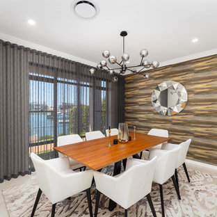 Photo of a contemporary dining room in Brisbane with brown walls and beige floor.