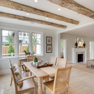 Mid-sized elegant light wood floor great room photo in DC Metro with beige walls, a standard fireplace and a stone fireplace