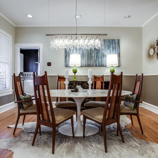 Enclosed dining room - mid-sized transitional medium tone wood floor enclosed dining room idea in Dallas with gray walls and no fireplace