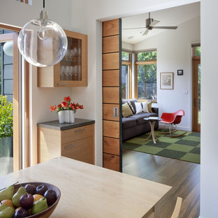 This is an example of a contemporary dining room in San Francisco with white walls and medium hardwood floors.