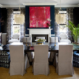 Example of a tuscan dark wood floor dining room design in Baltimore with blue walls and a standard fireplace