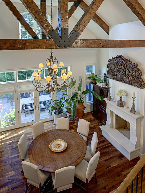 Inspiration For A Timeless Dark Wood Floor Dining Room Remodel In Seattle With White Walls And