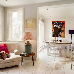 Dining room - shabby-chic style painted wood floor and white floor dining room idea in London with white walls