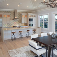 Transitional Dining Room by Rob Bowen Design Group