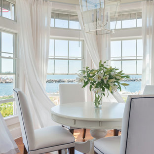 Dining room - mid-sized beach style medium tone wood floor dining room idea in Providence with white walls