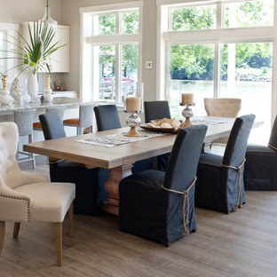 This is an example of a large beach style kitchen/dining room in Orlando with grey walls, vinyl flooring and grey floors.