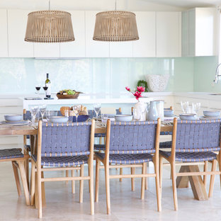 Photo of a mid-sized beach style open plan dining in Sydney with travertine floors and beige floor.