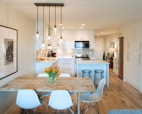 dining room table with bench against wall. Small beach style light wood floor great room idea in Vancouver with white  walls Table Against Wall Dining Room Ideas Photos Houzz