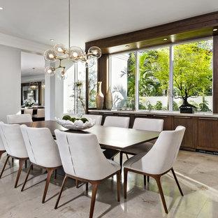 Imagen de comedor contemporáneo con suelo de mármol, paredes grises y suelo beige