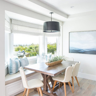 Coastal light wood floor dining room photo in Los Angeles with gray walls and no fireplace