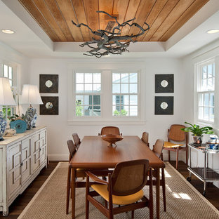 Inspiration for a tropical dark wood floor enclosed dining room remodel in Miami with white walls