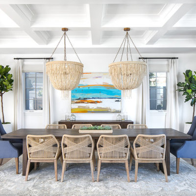 Mid-sized beach style medium tone wood floor and gray floor great room photo in Orange County with white walls and no fireplace