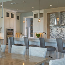 Beach Style Dining Room by Charles Clayton Construction Inc